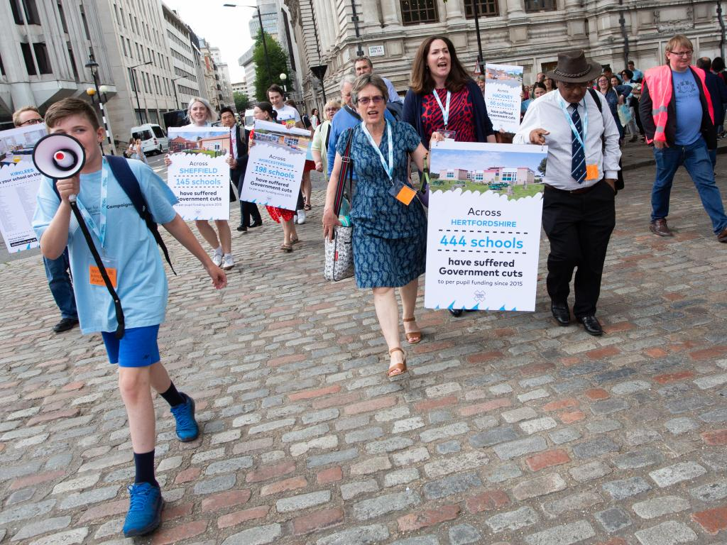 Together for Education protesters walking with placards