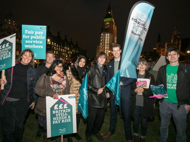 NEU members rally against education cuts