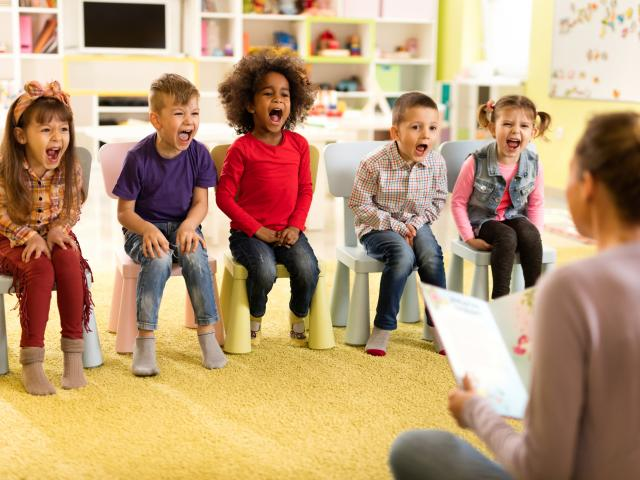 Group of children screaming during storytelling