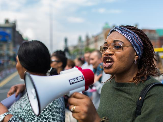 Woman protestor with megaphone