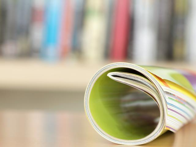 Close up edge of colourful magazine stacking roll