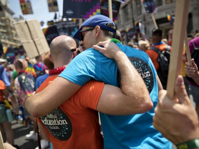 Members hugging pride 2018