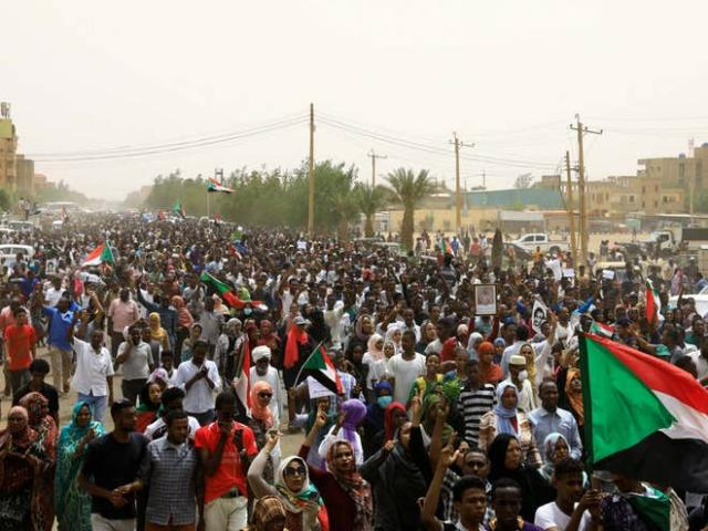 Protestors demonstrate against the military regime in Sudan, June 2019